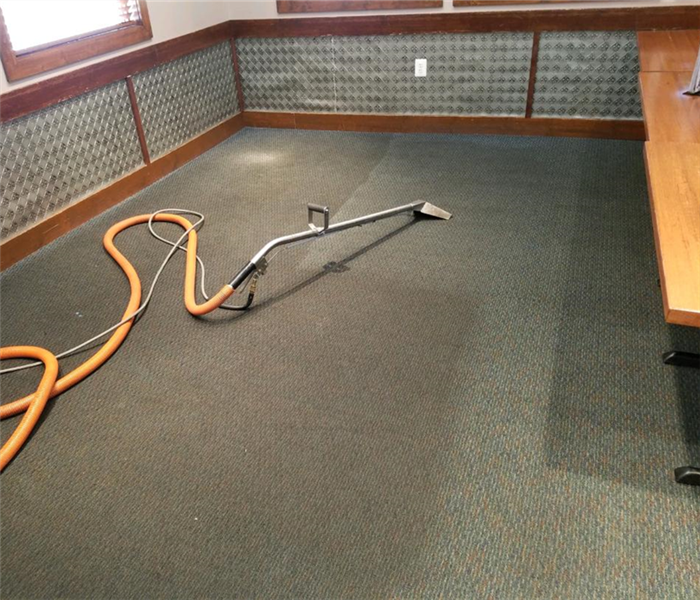 before & after of carpet cleaning done at a local restaurant