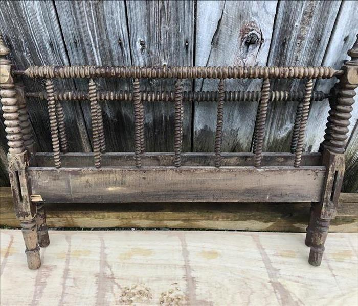 soot and paint covering an antique bed frame