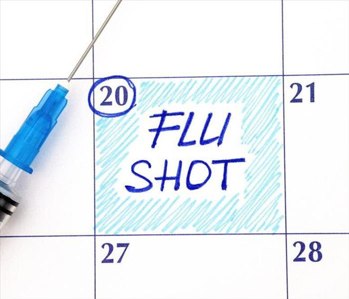 Flu Shot in blue writing scheduled on a calendar