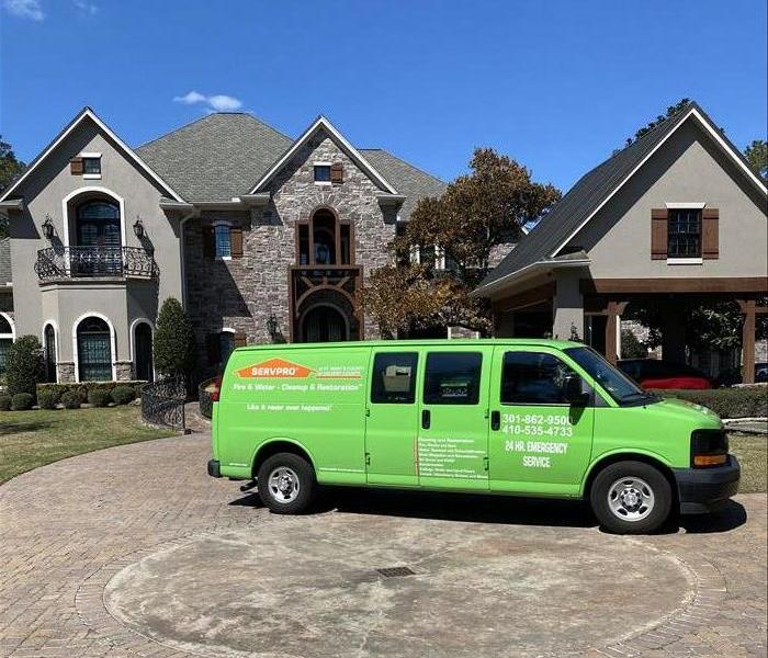van in front of huge house