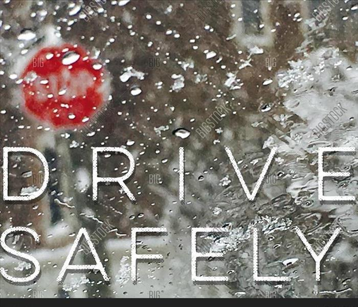 drive safely written with a frosty snow scene in the background